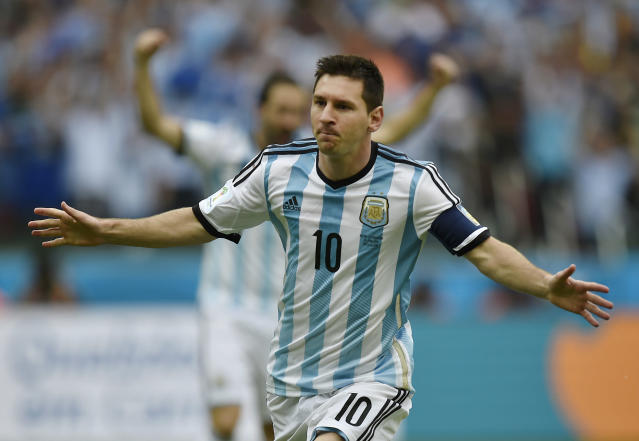 Argentina's Lionel Messi celebrates after scoring his side's first goal during the group F World Cup soccer match against Nigeria at the Estadio Beira-Rio in Porto Alegre, Brazil, Wednesday, June 25, 2014. (AP Photo/Martin Meissner)