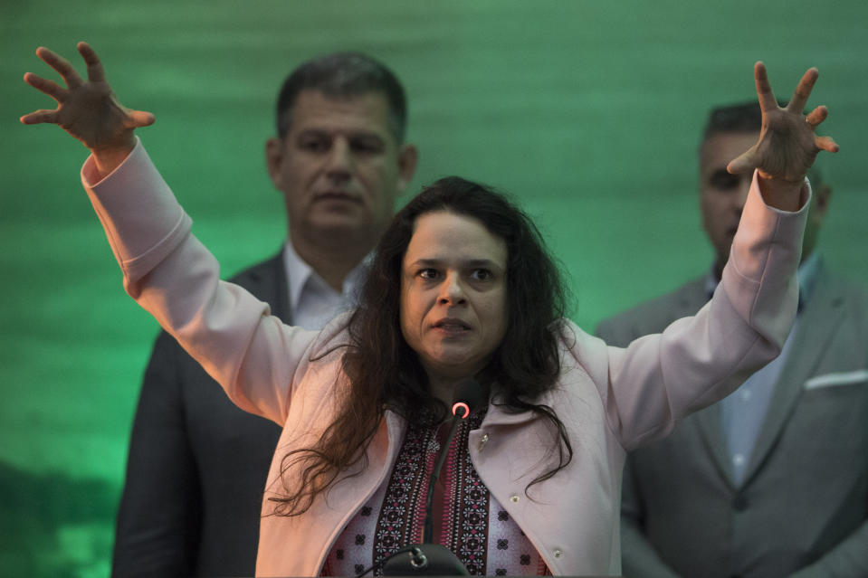 Lawyer Janaina Paschoal addresses the National Social Liberal Party convention where far-right Congressman Jair Bolsonaro was nominated the party's presidential candidate in Rio de Janeiro, Brazil, Sunday, July 22, 2018. Paschoal was the lead lawyer who presented the case against former President Dilma Rousseff during her impeachment process. (AP Photo/Leo Correa)