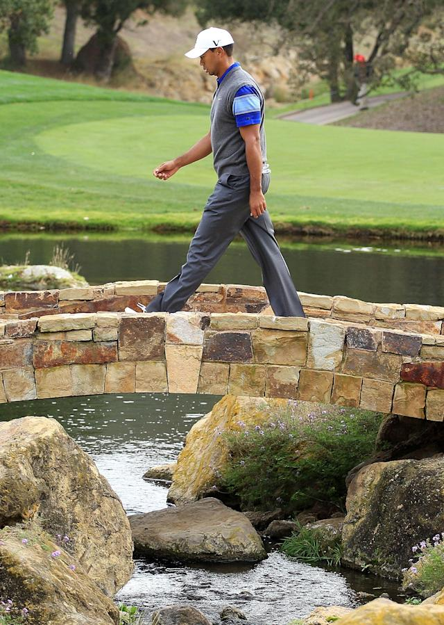 THOUSAND OAKS, CA - DECEMBER 02: Tiger Woods crosses a bridge on the 18th hole during the second round of the Chevron World Challenge at Sherwood Country Club on December 2, 2011 in Thousand Oaks, California. (Photo by Scott Halleran/Getty Images)