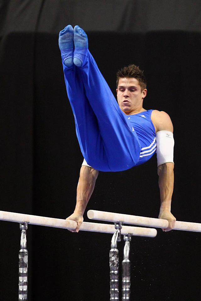 ST. LOUIS, MO - JUNE 9: Chris Brooks competes on the parallel bars during the Senior Men's competition on Day Three of the Visa Championships at Chaifetz Arena on June 9, 2012 in St. Louis, Missouri. (Photo by Dilip Vishwanat/Getty Images)
