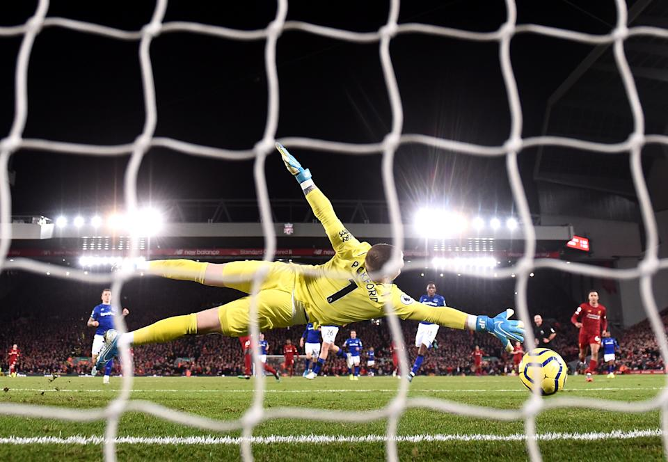 LIVERPOOL, ENGLAND - DECEMBER 04: Sadio Mane of Liverpool scores his team's fourth goal past Jordan Pickford of Everton during the Premier League match between Liverpool FC and Everton FC at Anfield on December 04, 2019 in Liverpool, United Kingdom. (Photo by Laurence Griffiths/Getty Images)