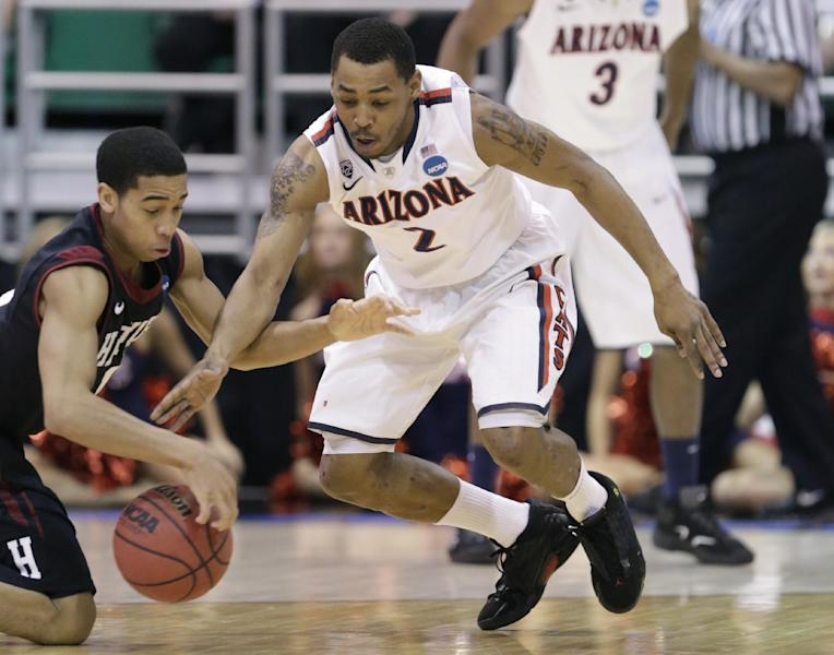 Harvard's Siyani Chambers (1) and Arizona's Mark Lyons (2) reach for a loose ball in the first half during a third-round game in the NCAA men's college basketball tournament in Salt Lake City, Saturday, March 23, 2013. (AP Photo/Rick Bowmer)