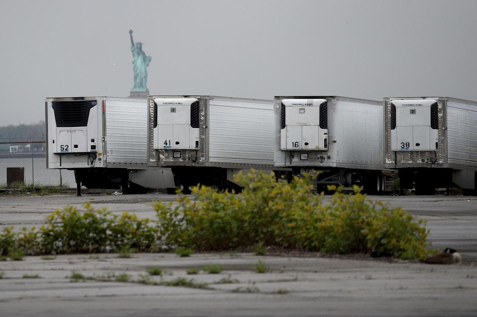 *** BESTPIX *** NEW YORK, NEW YORK - MAY 06: Refrigerated trucks functioning as temporary morgues are seen at the South Brooklyn Marine Terminal on May 06, 2020 in the Brooklyn borough of New York City. New York City's Medical Examiner are now operating a long-term disaster morgue at Brooklyn's 39th Street Pier, where human remains will be kept inside freezer trucks, in an effort to provide relief to funeral directors overwhelmed from the COVID-19 crisis. (Photo by Justin Heiman/Getty Images) (Getty Images)