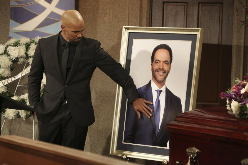 "CORRECTS CHARACTER NAME FROM MORGAN TO WINTERS - This image released by CBS shows Shemar Moore portraying Malcolm Winters during a funeral scene for the character Neil Winters, portrayed by the late actor Kristoff St. John, in the daytime series ""The Young and the Restless.""  St. John, who died at age 52 in February of heart disease, helped cement the prominence of major African-American characters in the traditionally white soap opera world. (Michael Yarish/CBS via AP)"