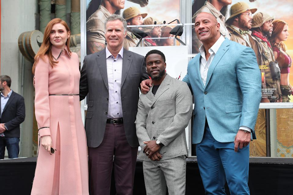HOLLYWOOD, CALIFORNIA - DECEMBER 10: Kevin Hart (C) poses with Karen Gillan (L) Will Ferrell (2L) and Dwayne Johnson Hand And Footprint Ceremony honoring Kevin Hart at TCL Chinese Theatre on December 10, 2019 in Hollywood, California. (Photo by Leon Bennett/WireImage)