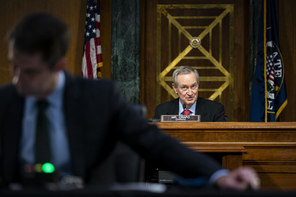 Chairman Mike Crapo, R-Idaho, speaks as Federal Reserve Chair Jerome Powell and Treasury Secretary Steven Mnuchin, not pictured, testify during a Senate Banking Committee hearing on Capitol Hill, on Tuesday, Dec. 1, 2020, in Washington. (Al Drago/The New York Times via AP, Pool)