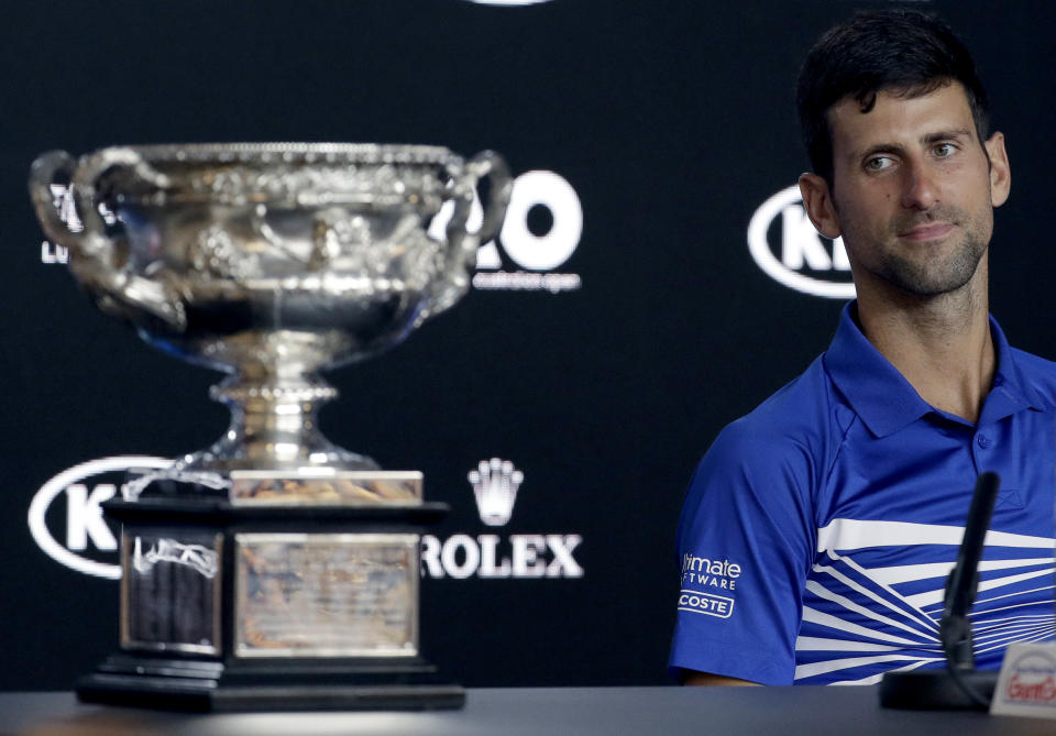 Serbia's Novak Djokovic answers questions at a press conference after defeating Spain's Rafael Nadal in the men's singles final at the Australian Open tennis championships in Melbourne, Australia, Sunday, Jan. 27, 2019. (AP Photo/Kin Cheung)