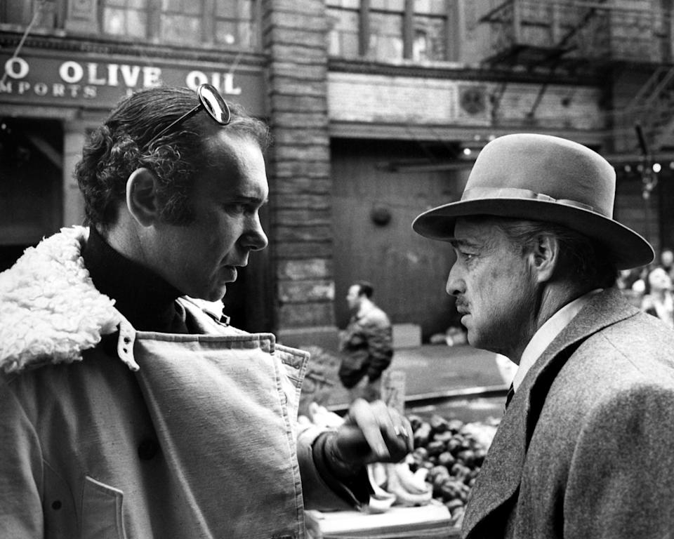 Producer Albert S. Ruddy (left) and actor Marlon Brando (1924 - 2004) on the set of 'The Godfather', directed by Francis Ford Coppola, Little Italy, Manhattan, New York City, 1972. (Photo by Silver Screen Collection/Getty Images)