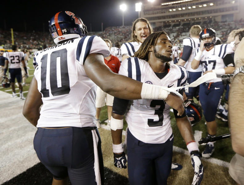 Mississippi running back Jeff Scott (3) is congratulated by defensive end C.J. Johnson (10) after Mississippi beat Vanderbilt 39-35 in an NCAA college football game on Friday, Aug. 30, 2013, in Nashville, Tenn. Scott scored a touchdown on a 75-yard run with 1:07 left in the fourth quarter to give Mississippi the win. (AP Photo/Mark Humphrey)
