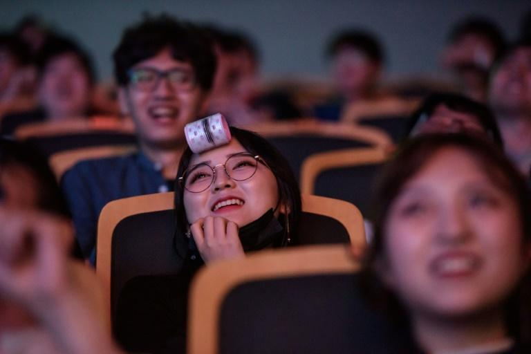 Spectators watch as professional eSports teams 'Griffin' and 'Afreeca Freaks' prepare to compete in a 'League of Legends' competition, in Seoul, on July 11, 2018