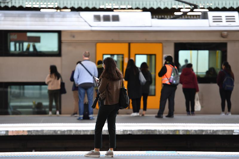Sydney commuters and school students return to public transport at Strathfield Train Station.