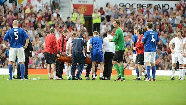 Gordon Ramsay gets stretchered off the Wembley pitch.