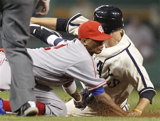 Pittsburgh Pirates' Jordy Mercer, right, is tagged out by Kansas City Royals shortstop Alcides Escobar trying to steal second in the eighth inning of the baseball game on Saturday, June 9, 2012, in Pittsburgh. The Pirates won 5-3. (AP Photo/Keith Srakocic)