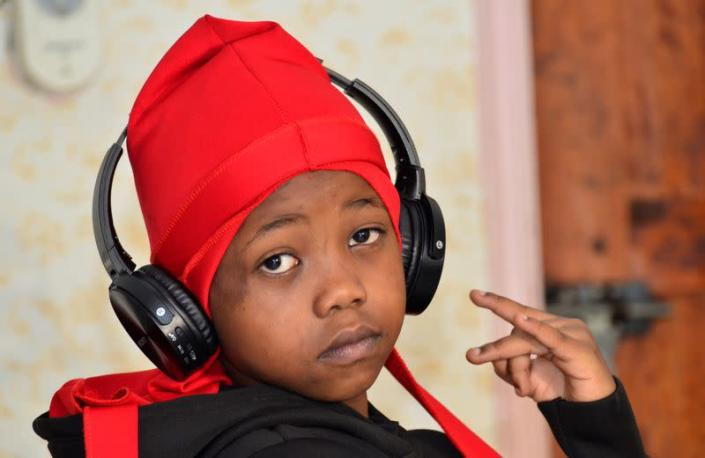 """Ugandan eight-year-old rapper """"Fresh Kid"""", whose real name is Patrick Ssenyonjo, poses for a picture during an interview with Reuters in Bukoto, a suburb of Kampala"""