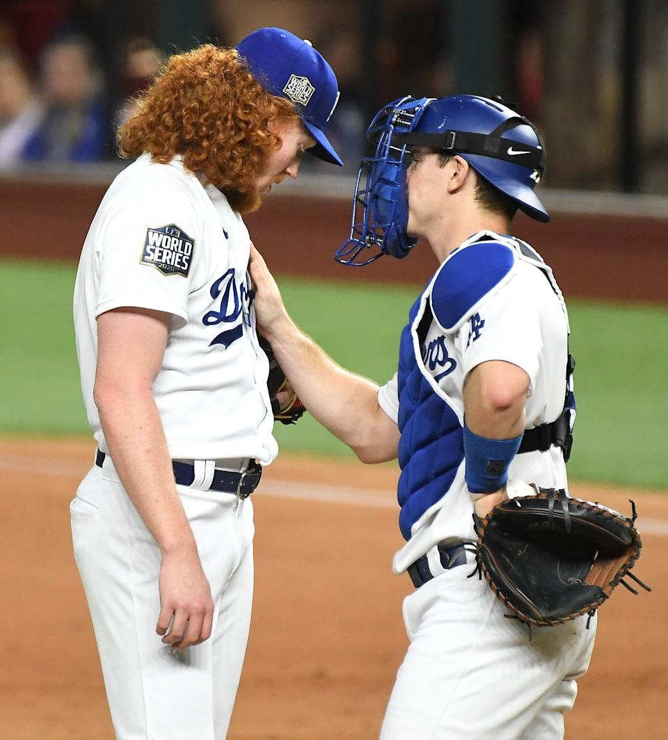Dodgers pitcher Dustin May speaks with catcher Will Smith after giving up a two-run home run against the Rays.