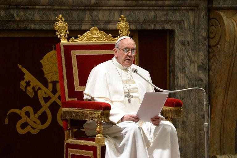 This picture released by the Vatican press office on March 15, 2013 shows Pope Francis delivering a speech during a meeting of the world's cardinals