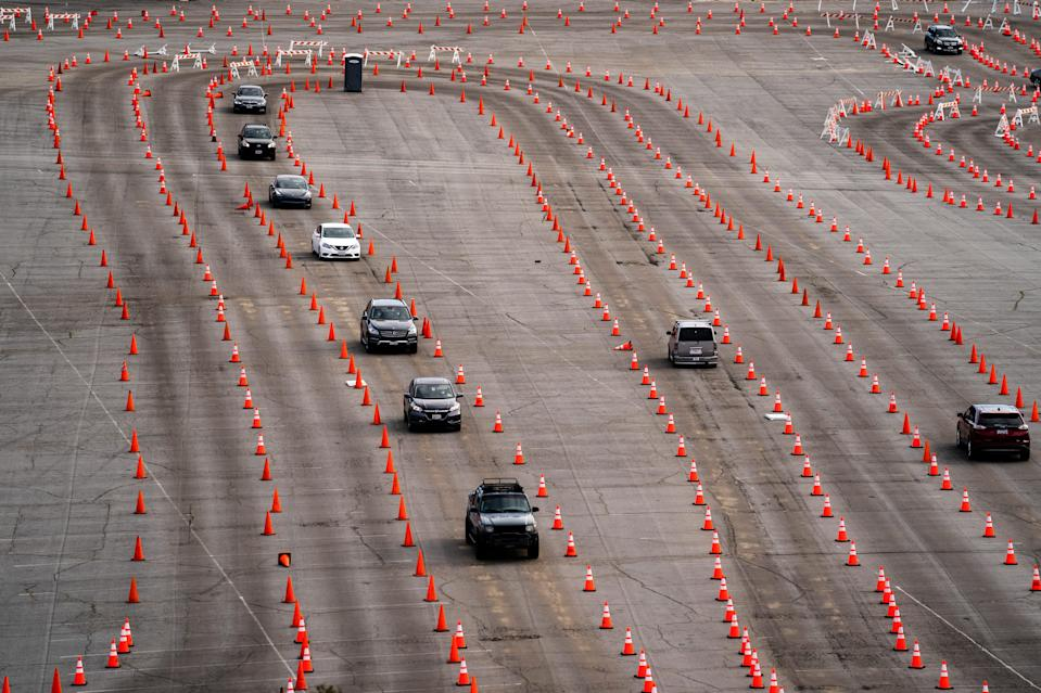 Traffic cones guide drivers into a COVID-19 mass vaccination site in the parking lot of Dodger Stadium in Los Angeles on Wednesday.