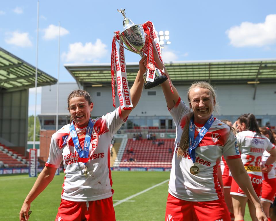 Rudge crossed for one of St Helens' seven tries as they lifted the Women's Challenge Cup trophy for the first time