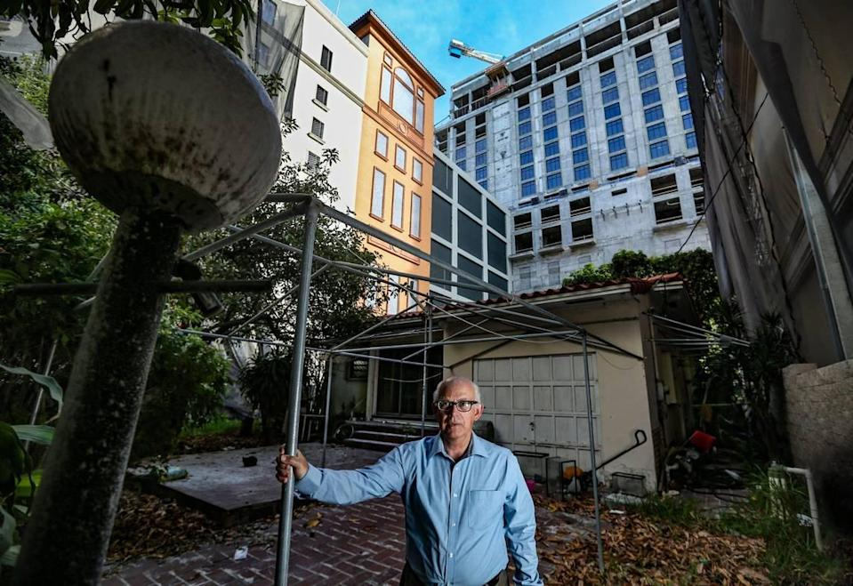 Orlando Capote has refused to move out of the house his parents bought in 1989, even as the Plaza Coral Gables development towers above him.