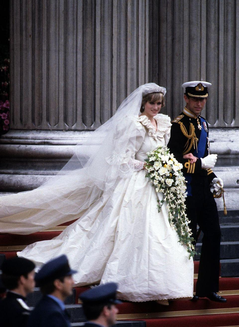 "<p>Princess Diana's show-stopping wedding dress had over 10,000 pearls and a <a href=""https://www.goodhousekeeping.com/beauty/fashion/g4655/princess-diana-wedding-dress/"" rel=""nofollow noopener"" target=""_blank"" data-ylk=""slk:25-foot wedding train"" class=""link rapid-noclick-resp"">25-foot wedding train</a>. Before her wedding started she actually spilled perfume on her gown, but Diana's team managed to hide it so no one noticed.</p>"