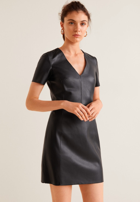 "<p>This faux-leather ""Seam body con dress"" from Mango is a more structured take on the leather-look mini-dress. The V-neck and cinched weight helps create a flattering silhouette while still keeping the look structured with its visible seams.<br /><br /><a rel=""nofollow"" href=""https://shop.mango.com/us/women/dresses-short/seam-bodycon-dress_33045743.html?c=99&n=1&s=prendas_she""><strong>SHOP IT – Mango $99 CAD</strong></a> </p>"