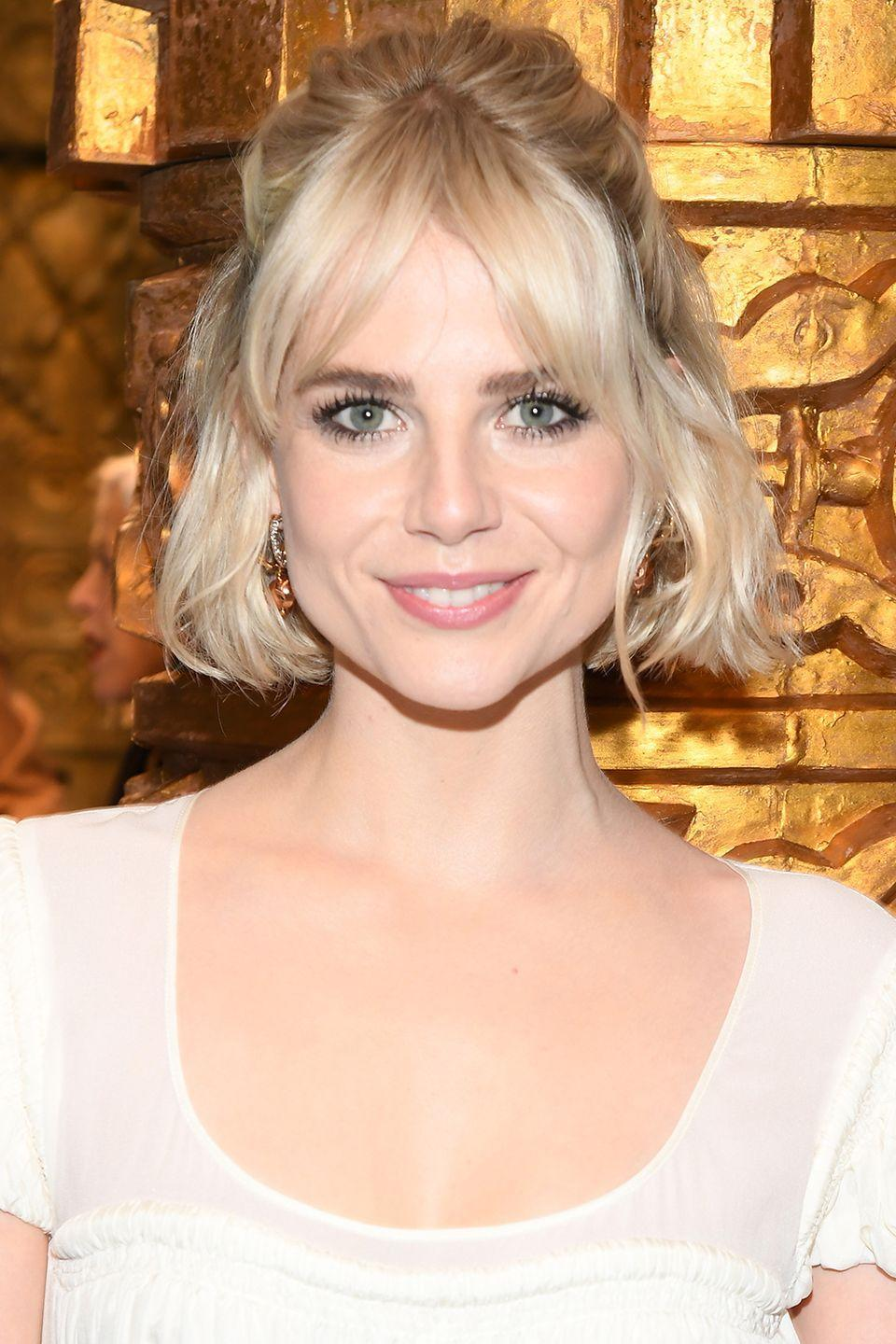 <p>You don't need long hair to get a cute half-up style. Just look to Lucy Boynton. Gather a few pieces and tie at the back with a strong elastic or a few pins, leaving shorter layers to fall naturally out front. </p>