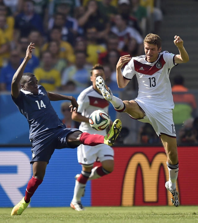 France's Blaise Matuidi, left, and Germany's Thomas Mueller battle for the ball during the World Cup quarterfinal soccer match between Germany and France at the Maracana Stadium in Rio de Janeiro, Brazil, Friday, July 4, 2014. (AP Photo/Martin Meissner)
