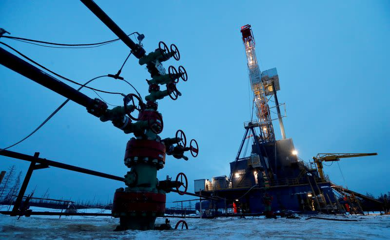 FILE PHOTO: A well head and drilling rig in the Yarakta oilfield in Russia