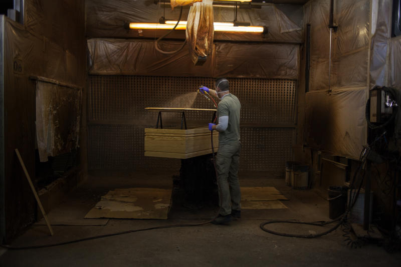 A coffin maker at the Eurocoffin coffins factory in Barcelona. (José Colon for Yahoo News)