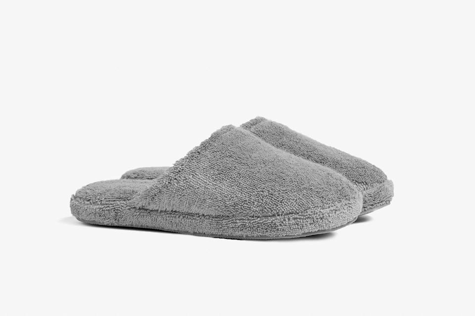 """Another foolproof gift: slippers. Made from 100-percent Turkish cotton terry, Parachute's plush slippers are soft and breathable, with rubber soles for a better grip. Order them in stone, as shown above, or white. $39, Parachute. <a href=""""https://www.parachutehome.com/products/classic-slippers?opt-color=stone"""" rel=""""nofollow noopener"""" target=""""_blank"""" data-ylk=""""slk:Get it now!"""" class=""""link rapid-noclick-resp"""">Get it now!</a>"""