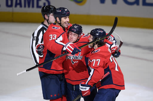 Washington Capitals left wing Jakub Vrana (13) celebrates his goal with defenseman Zdeno Chara (33) and right wing T.J. Oshie (77) during the second period of an NHL hockey game against the Buffalo Sabres, Friday, Jan. 22, 2021, in Washington. (AP Photo/Nick Wass)