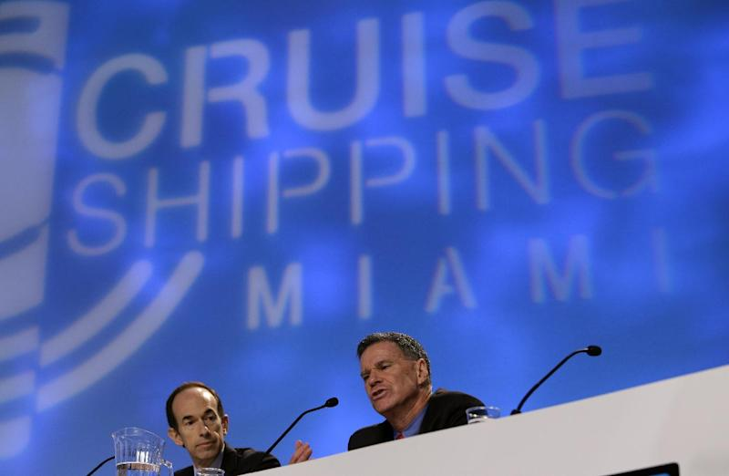 "Gerry Cahill, right, president and CEO of Carnival Cruise Lines, speaks during the State of the Industry session at the 29th annual Cruise Shipping Miami conference, Tuesday, March 12, 2013, in Miami Beach, Fla. Carnival Cruise Line's highest priority is to look at ""learnings and potential changes"" that can be made after the Triumph stranding last month, said Cahill. At left is Adam Goldstein, president and CEO of Royal Caribbean International. (AP Photo/Lynne Sladky)"