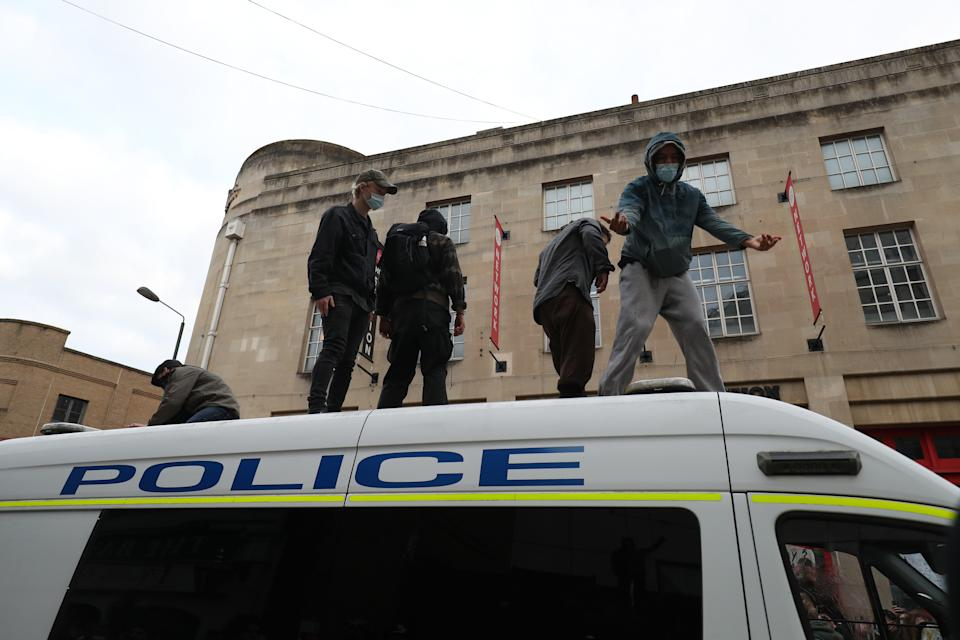 People on top of a police van in front of Bridewell Police Station as they take part in a 'Kill the Bill' protest in Bristol, demonstrating against the Government's controversial Police and Crime Bill. Picture date: Sunday March 21, 2021.