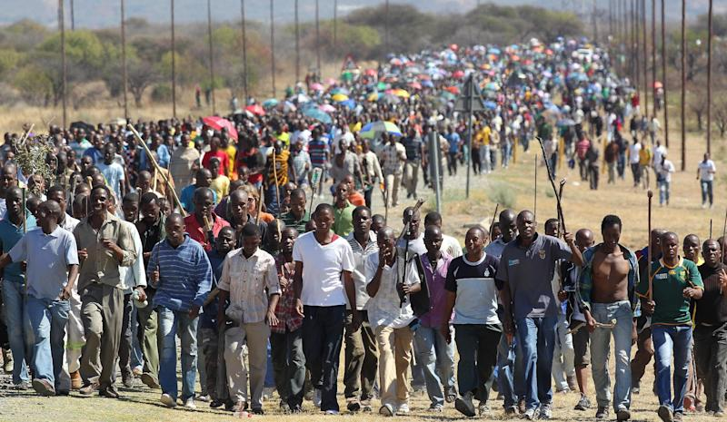 Miners march to Lonmin Platinum Mine near Rustenburg, South Africa, Monday, Sept. 10, 2012, in an attempt to stop operations. Union rivalry is at the root of violent illegal strikes that have been troubling the mining industry that is the engine driving Africa's largest economy. (AP Photo/Themba Hadebe)