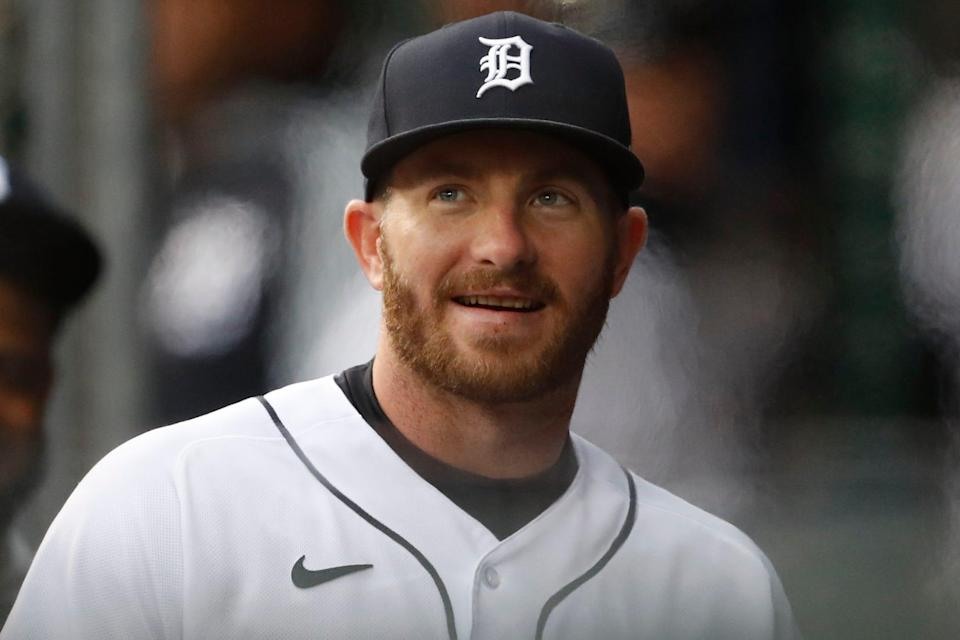 Detroit Tigers left fielder Robbie Grossman (8) smiles from the dugout before the game against the New York Yankees at Comerica Park on May 28, 2021.