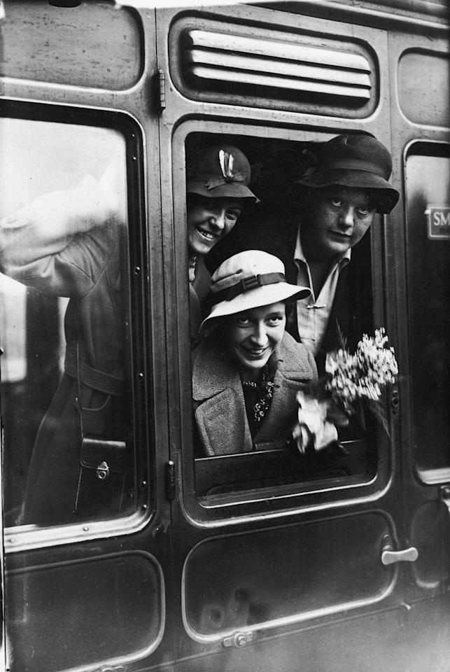 [ICCWWC2013] Betty Archdale (1907 - 2000, top right), captain of the English Women's cricket team, with two other members of the team at St Pancras Station, 19th October 1934. They are leaving for Australia to take part in the Test Matches. (Photo by J. A. Hampton/Topical Press Agency/Hulton Archive/Getty Images)