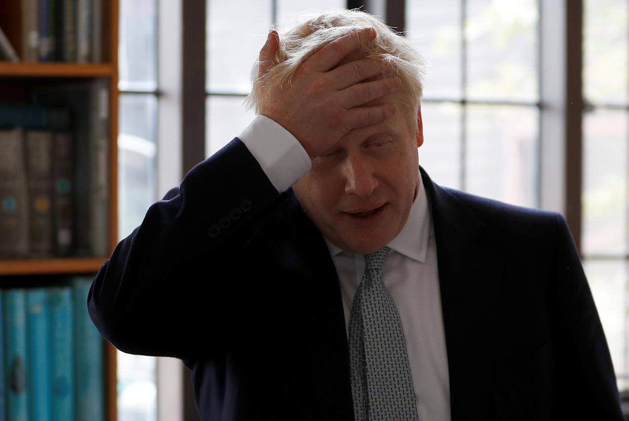 Boris Johnson, a leadership candidate for Britain's Conservative Party, gestures during his visit at Wisley Garden Centre in Surrey, Britain, June 25, 2019. REUTERS/Peter Nicholls