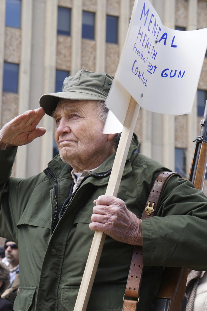 <p>Roy Fansler stands with an M1 Garand rifle at a gun rally Saturday, April 14, 2018, in front of the Wyoming Supreme Court in Cheyenne, Wyo. About 100 people took part including a handful openly carrying firearms. (Photo: Mead Gruver/AP) </p>