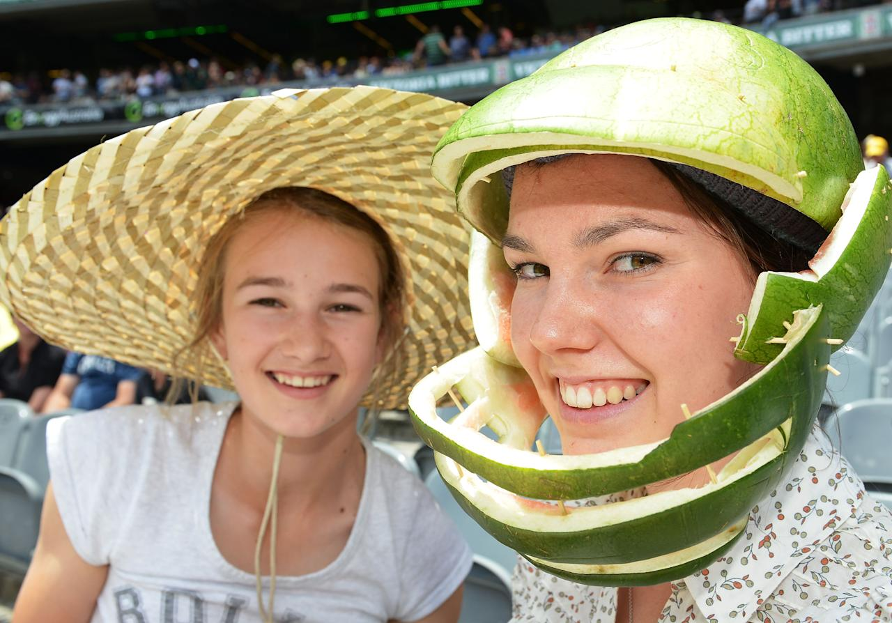 MELBOURNE, AUSTRALIA - DECEMBER 27:  A general view of Australian fans Georgia Mathewson (R) and sister Amelia during day two of the Second Test match between Australia and Sri Lanka at Melbourne Cricket Ground on December 27, 2012 in Melbourne, Australia.  (Photo by Vince Caligiuri/Getty Images)