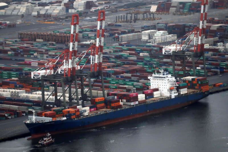 A container ship is seen docked at the port of New York and New Jersey in Bayonne