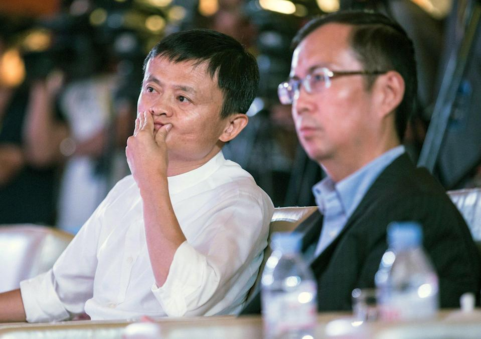 Alibaba founder Jack Ma (left) and CEO Zhang Yong during an event in Nanjing, Jiangsu province on 10 August 2015. Photo: EPA-EFE