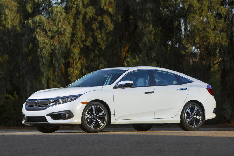 This undated photo provided by Honda shows the 2016 Honda Civic, a compact car with lots of technology and safety features. Buyers looking to save some money can buy a lightly used version that offers the same features as a new model. (American Honda Motor Co. via AP)