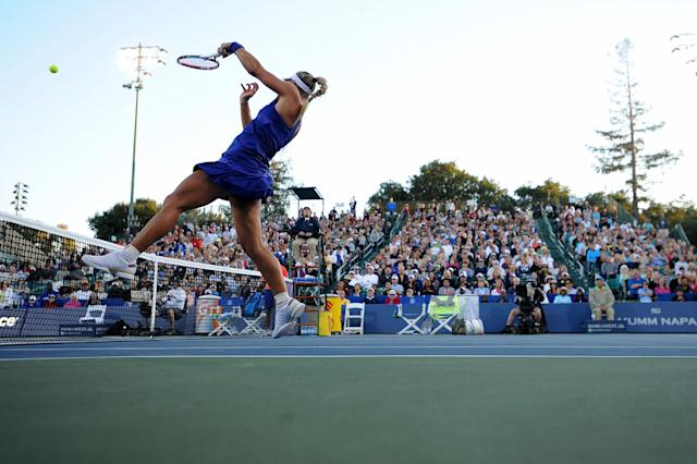 Angelique Kerber hits a high return against Varvara Lepchenko at the Bank of the West Classic at the Taube Family Tennis Stadiumon August 2, 2014 in Stanford, California (AFP Photo/Noah Graham)