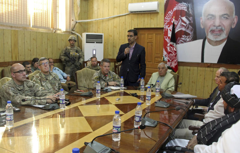 The head of NATO troops in Afghanistan, Gen. Scott Miller, center left, Kandahar Gov. Zalmay Wesa, center right, and their delegations attend a security conference, in Kandahar, Afghanistan, Thursday, Oct. 18, 2018. The three top officials in Afghanistan's Kandahar province were killed, including Wesa, when their own guards opened fire on them at the conference Thursday, the deputy provincial governor said. A Taliban spokesman said the target was Miller, who escaped without injury, according to NATO. (AP Photo)