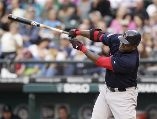 Boston Red Sox's David Ortiz hits a ball deep to left field that was caught by Seattle Mariners' Chone Figgins in the fourth inning of a baseball game, Friday, June 29, 2012, in Seattle. (AP Photo/Ted S. Warren)