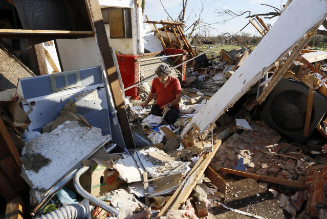 Charles Maloney tries to salvage papers from his tornado-destroyed home on Heather Lane in Moore, Oklahoma May 21, 2013. Rescuers went building to building in search of victims and thousands of survivors were homeless on Tuesday after a massive tornado tore through the Oklahoma City suburb of Moore, wiping out whole blocks of homes and killing at least 24 people. REUTERS/Rick Wilking (UNITED STATES - Tags: DISASTER ENVIRONMENT) - RTXZVQ9