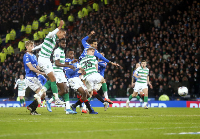 Celtic's Christopher Jullien scores his side's first goal of the game during the Scottish Cup soccer Final between Celtic and Rangers at Hampden Park, Glasgow, Scotland, Sunday, Dec. 8, 2019. (Jeff Holmes/PA via AP)