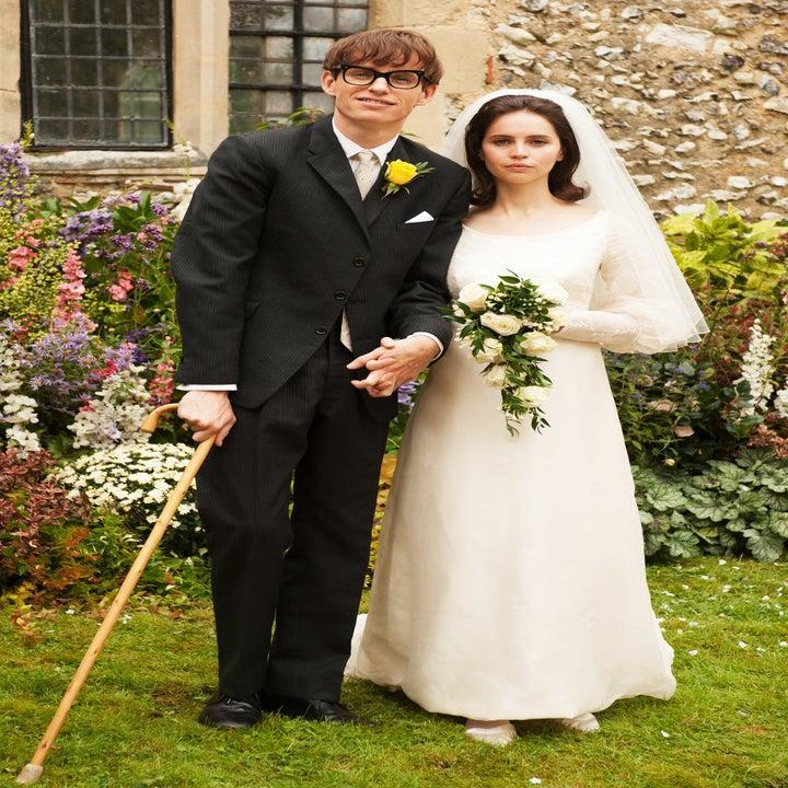 Steve Hawking and Jane Hawking wearing a suit and a wedding dress, respectively, on their wedding in The Theory of Everything