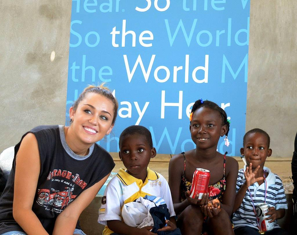 """A couple of months later, Miley was all smiles after making her second trip to Haiti with the Starkey Hearing Foundation. The singer helped distribute hearing aids to more than 400 Haitians. """"After I went on my first mission to Haiti with the Starkey Hearing Foundation, I felt so drawn to helping others hear for the first time and immediately wanted to look for another chance to go back and help again,"""" Miley said in a statement. """"This second mission to Haiti was just as impactful to me as the first one. I grew up around music and couldn't imagine what it would be like for my siblings and me, if we couldn't hear the magic of music. It's had such an influence on my life, that I just want everyone to enjoy sound as it was intended.""""  (10/10/2011)"""