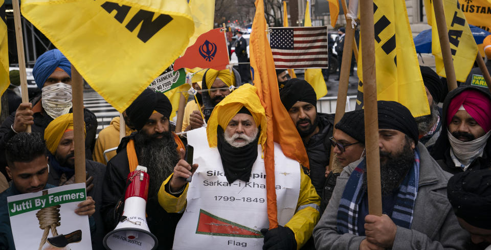 Protesters gather on Fifth Avenue after NYPD officer closed down the street outside the Consulate General of India, Tuesday, Jan. 26, 2021, in the Manhattan borough of New York. Tens of thousands of protesting farmers have marched, rode horses and drove long lines of tractors into India's capital, breaking through police barricades to storm the historic Red Fort. The farmers have been demanding the withdrawal of new laws that they say will favor large corporate farms and devastate the earnings of smaller scale farmers. Republic Day marks the anniversary of the adoption of India's constitution on Jan. 26, 1950. (AP Photo/John Minchillo)